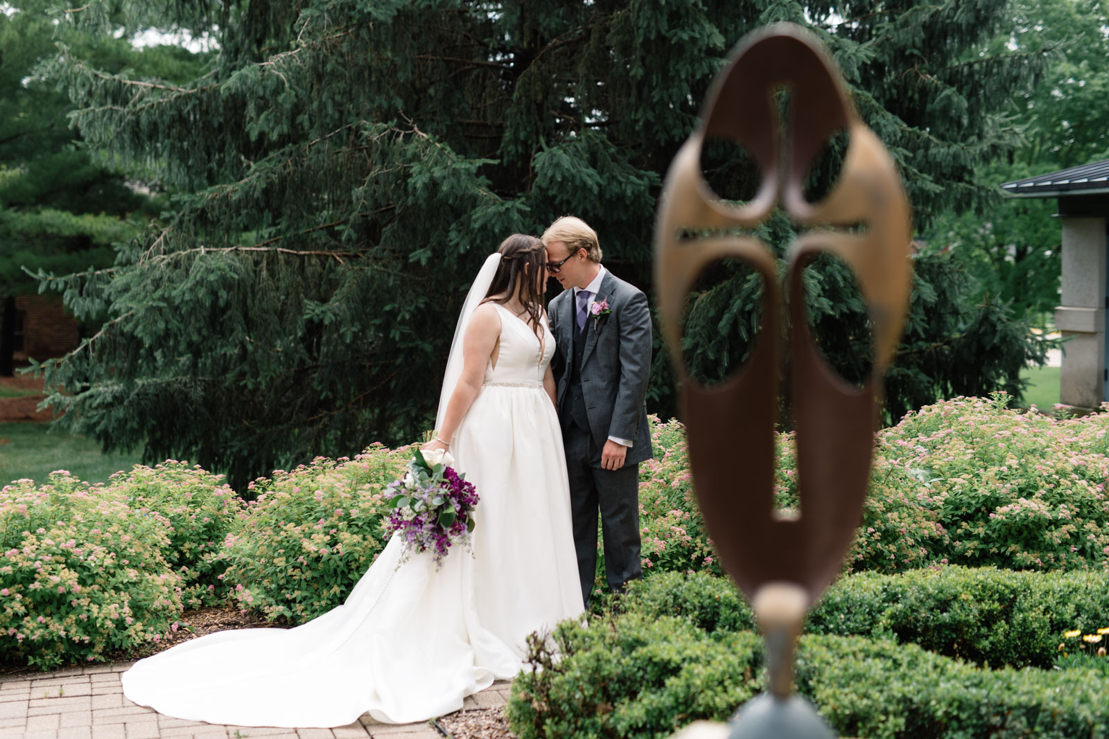 bride and groom in courtyard at wartburg college wedding