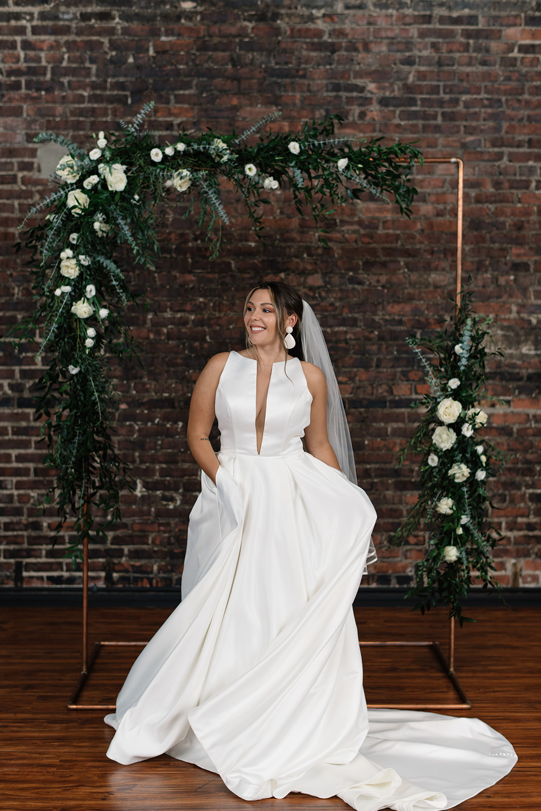 bride twirling in dress white rose copper arbor olympic south side theater wedding venue