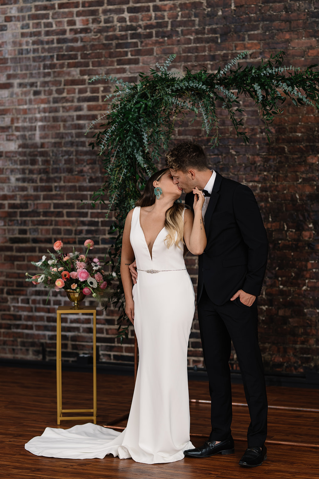couple under copper wedding altar brick wall olympic south side theater wedding venue
