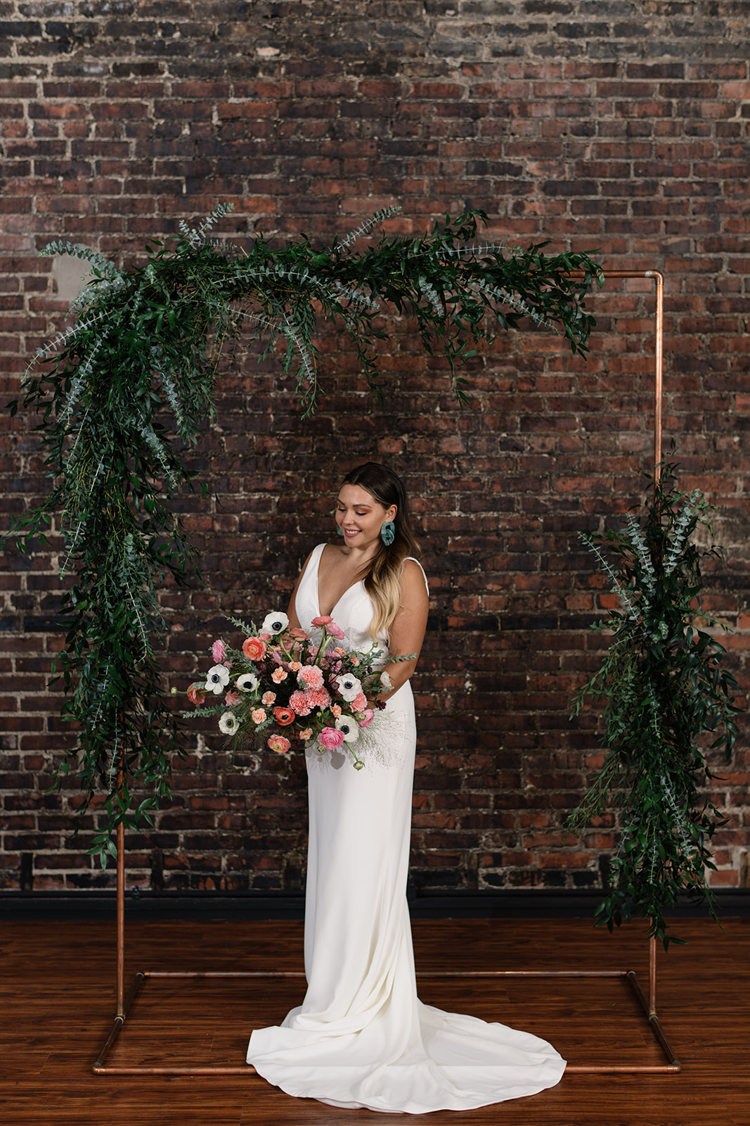 bride under copper wedding altar brick wall olympic south side theater wedding venue