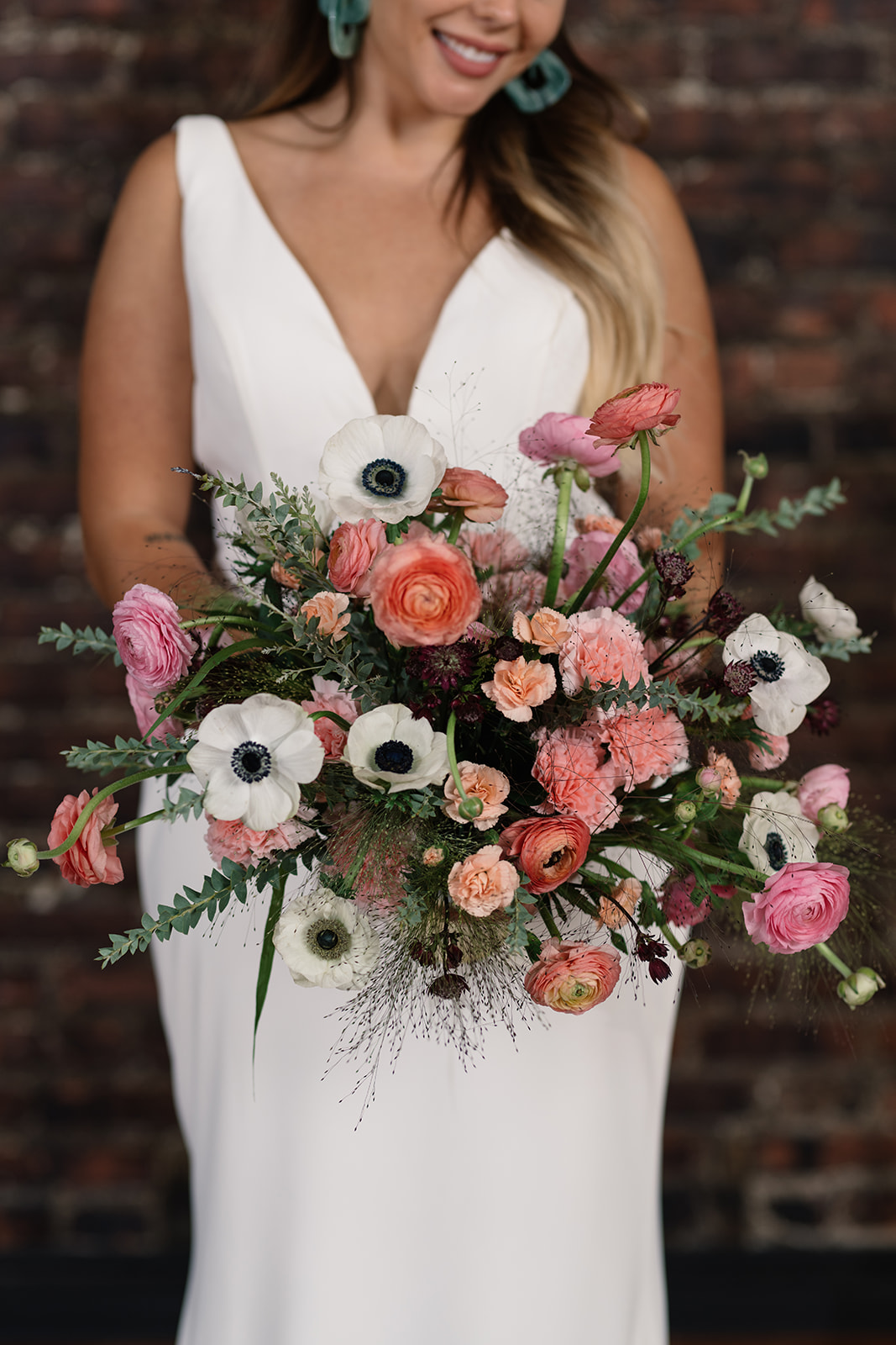 bold wedding bouquet olympic south side theater wedding venue anne and ellis events