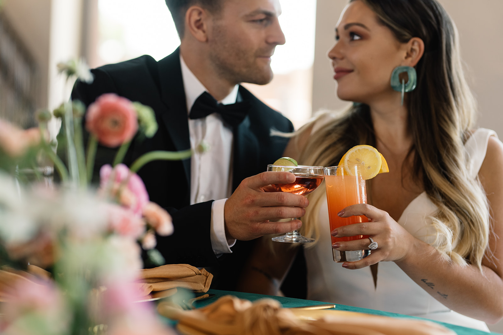 couple sharing cocktails olympic south side theater wedding venue cedar rapids
