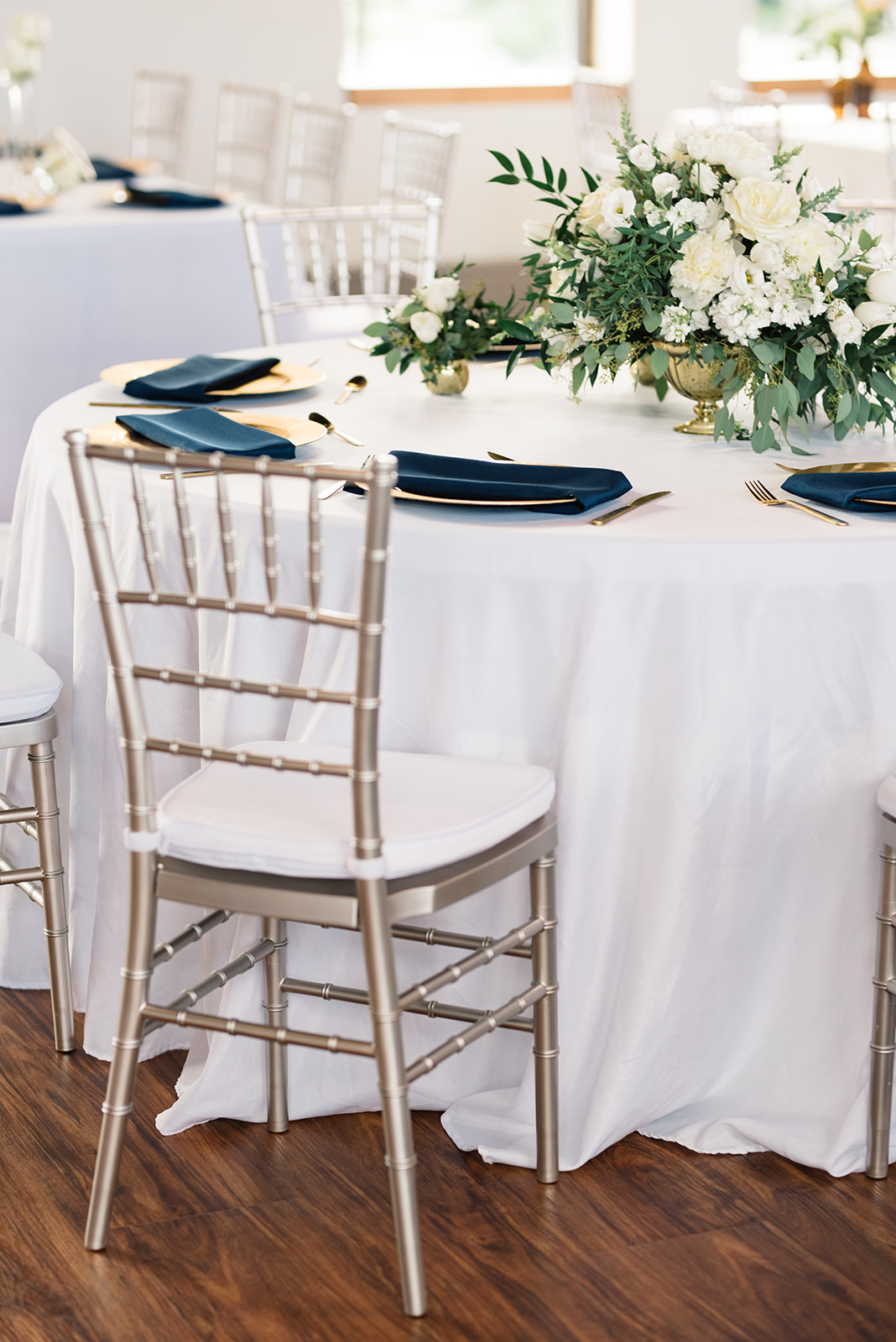 white gold and navy table decor olympic south side theater anne and ellis events