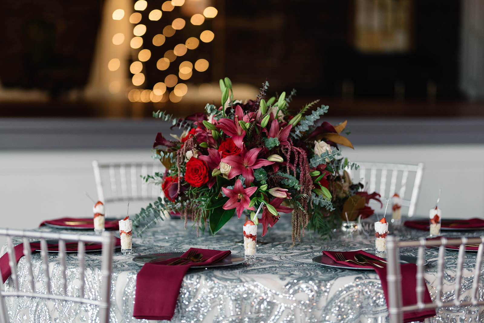 red and pink floral bouquet olympic south side theater wedding venue cedar rapids