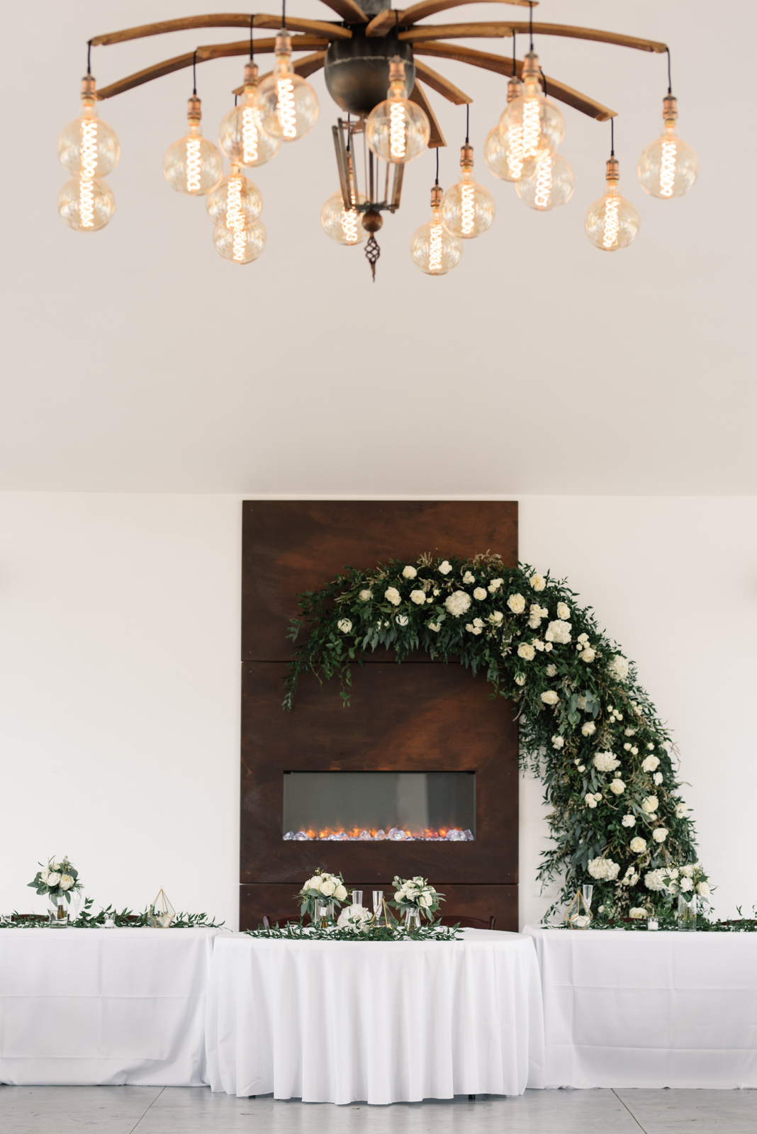 flower arch above fireplace koru berry farm wedding venue