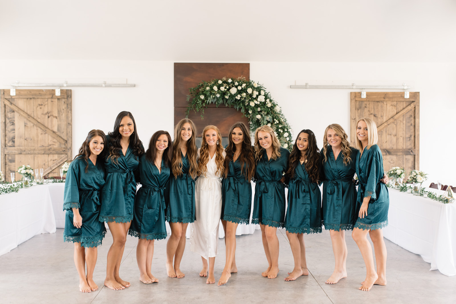 bridemaids and bride in robes koru berry wedding venue