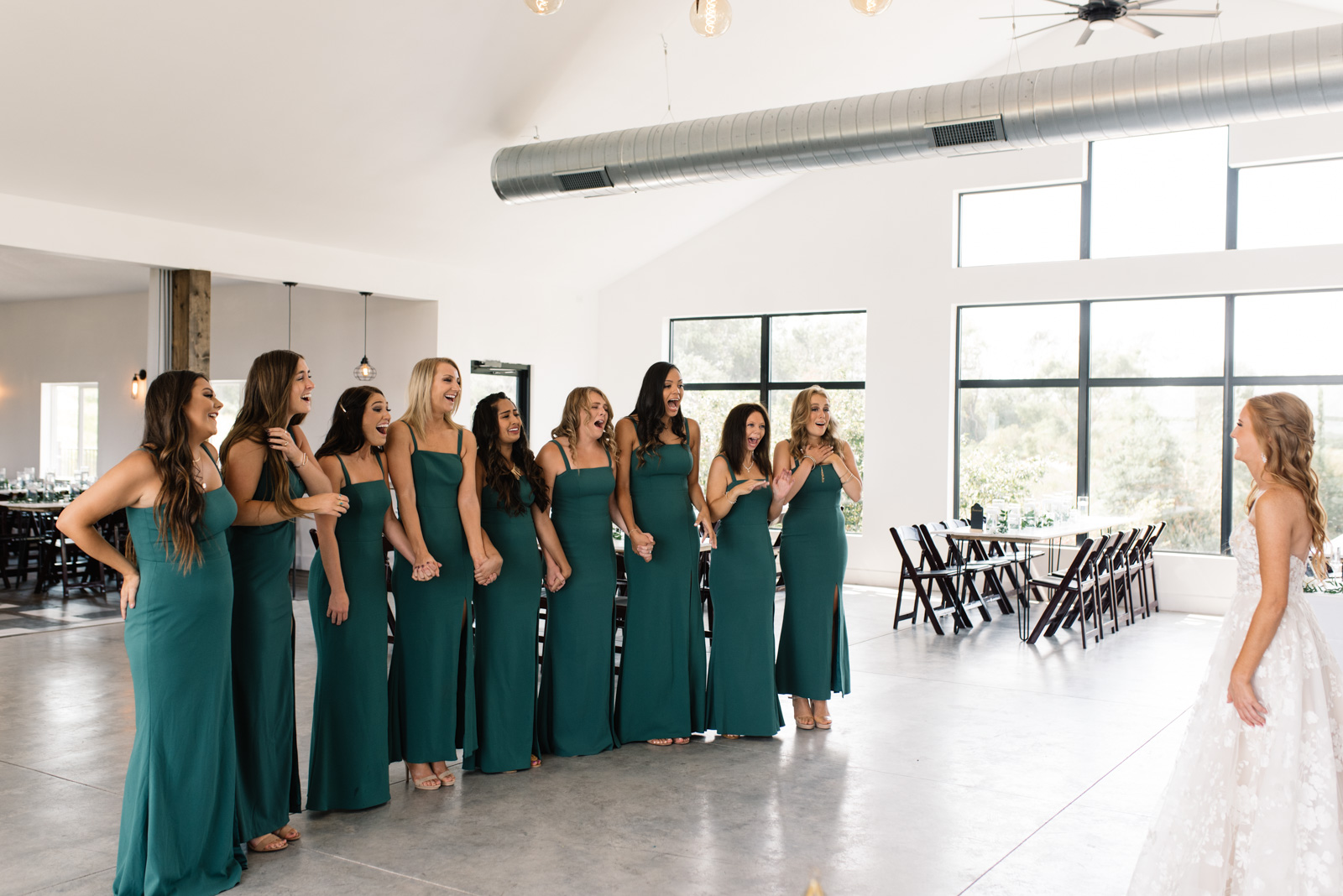 bride first look with bridesmaids koru berry farm wedding venue