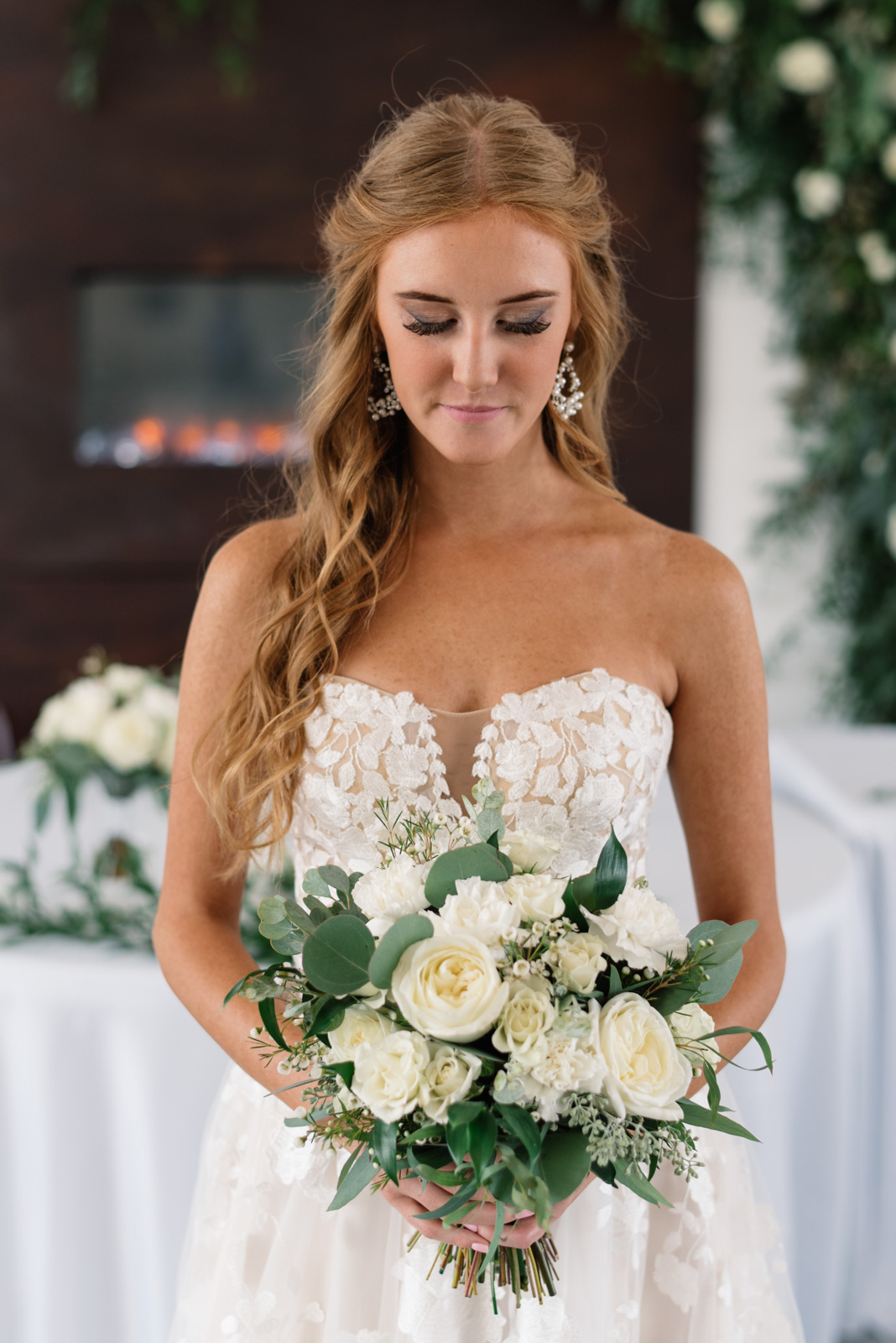 bride holds white rose wedding bouquet koru berry farm wedding venue