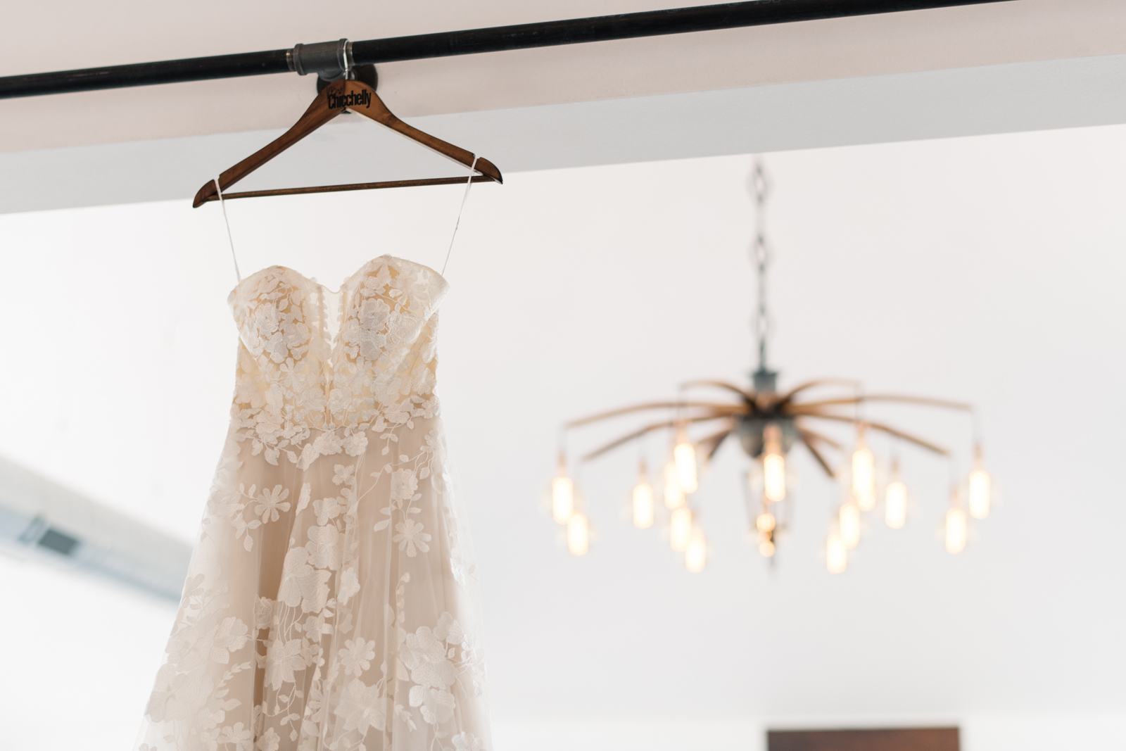 wedding dress hanging in koru berry farm wedding venue