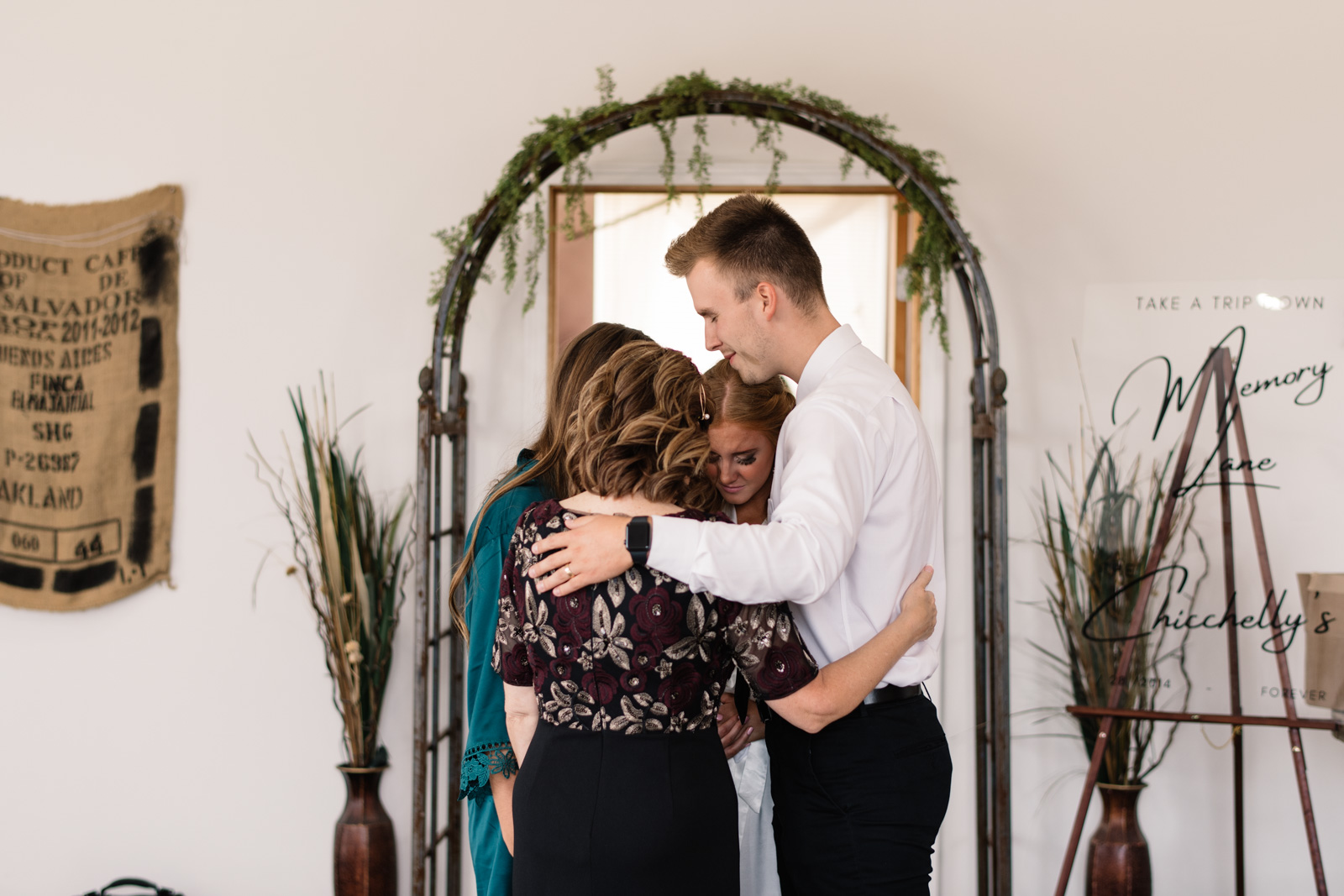 family prays with bride before wedding
