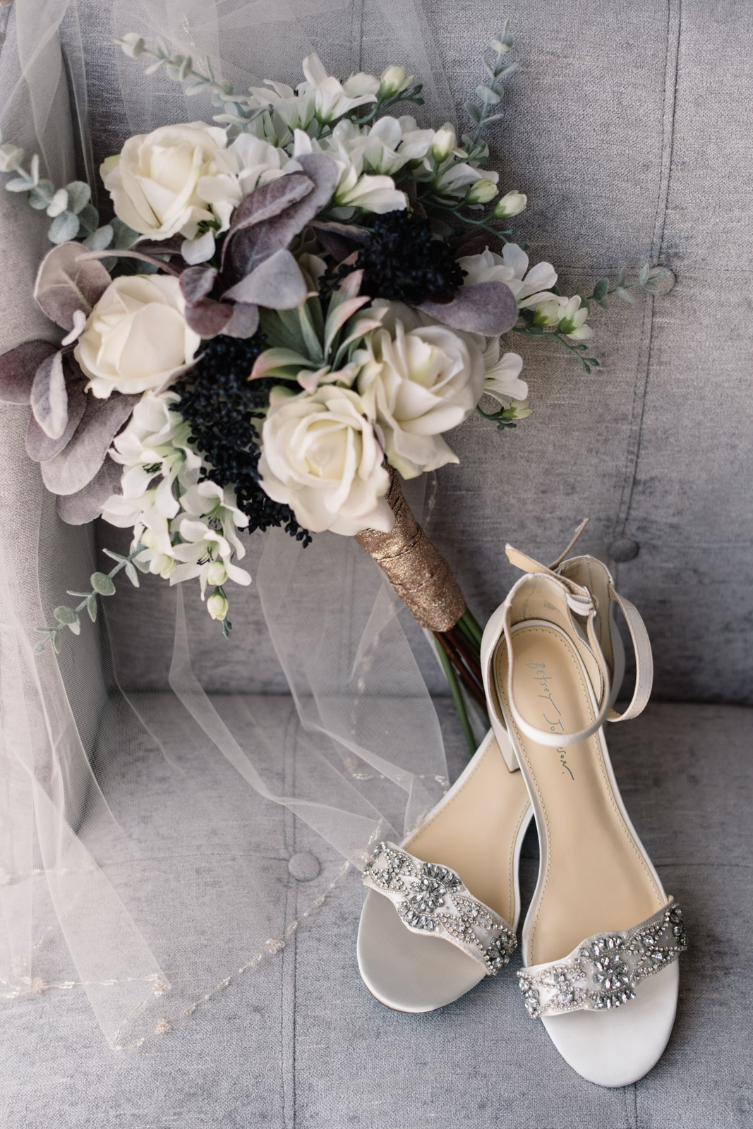 wedding shoes bouquet and veil on chair
