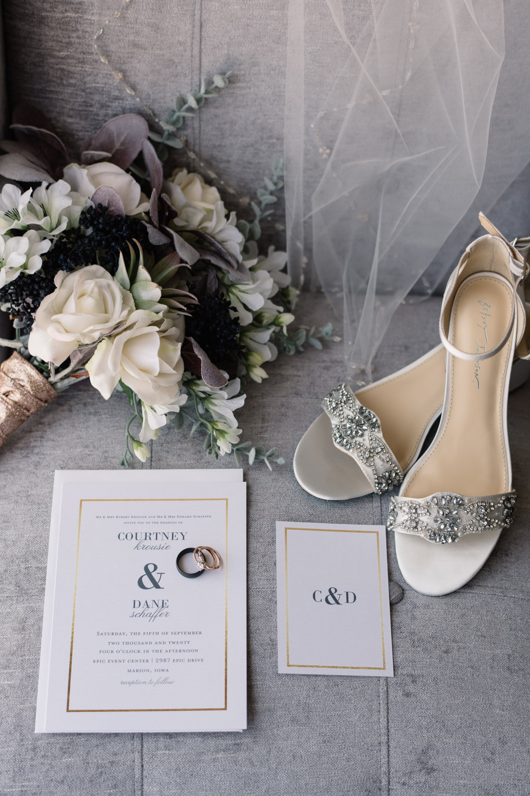 wedding shoes bouquet invitations and veil on chair
