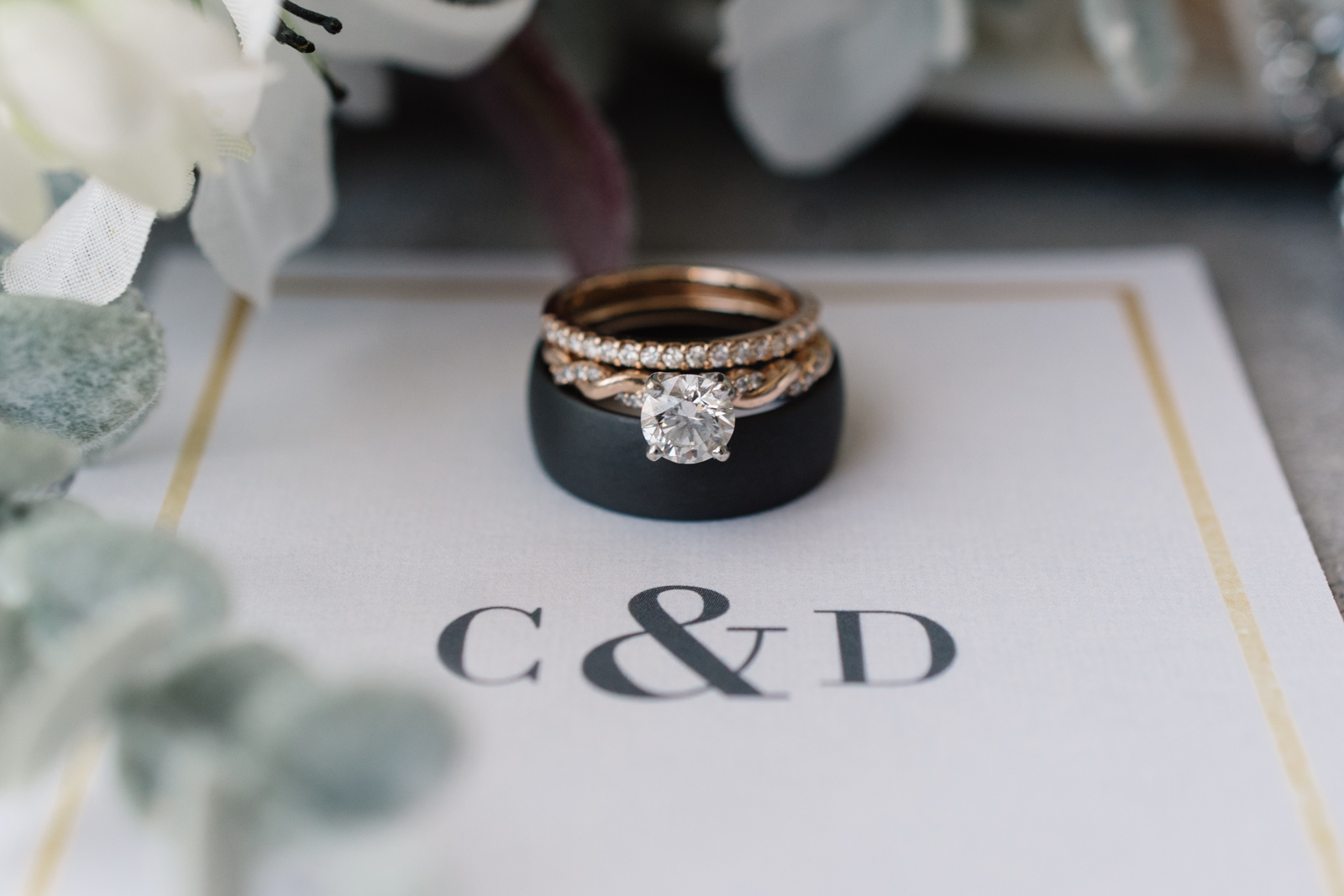 wedding rings with monogrammed invitations