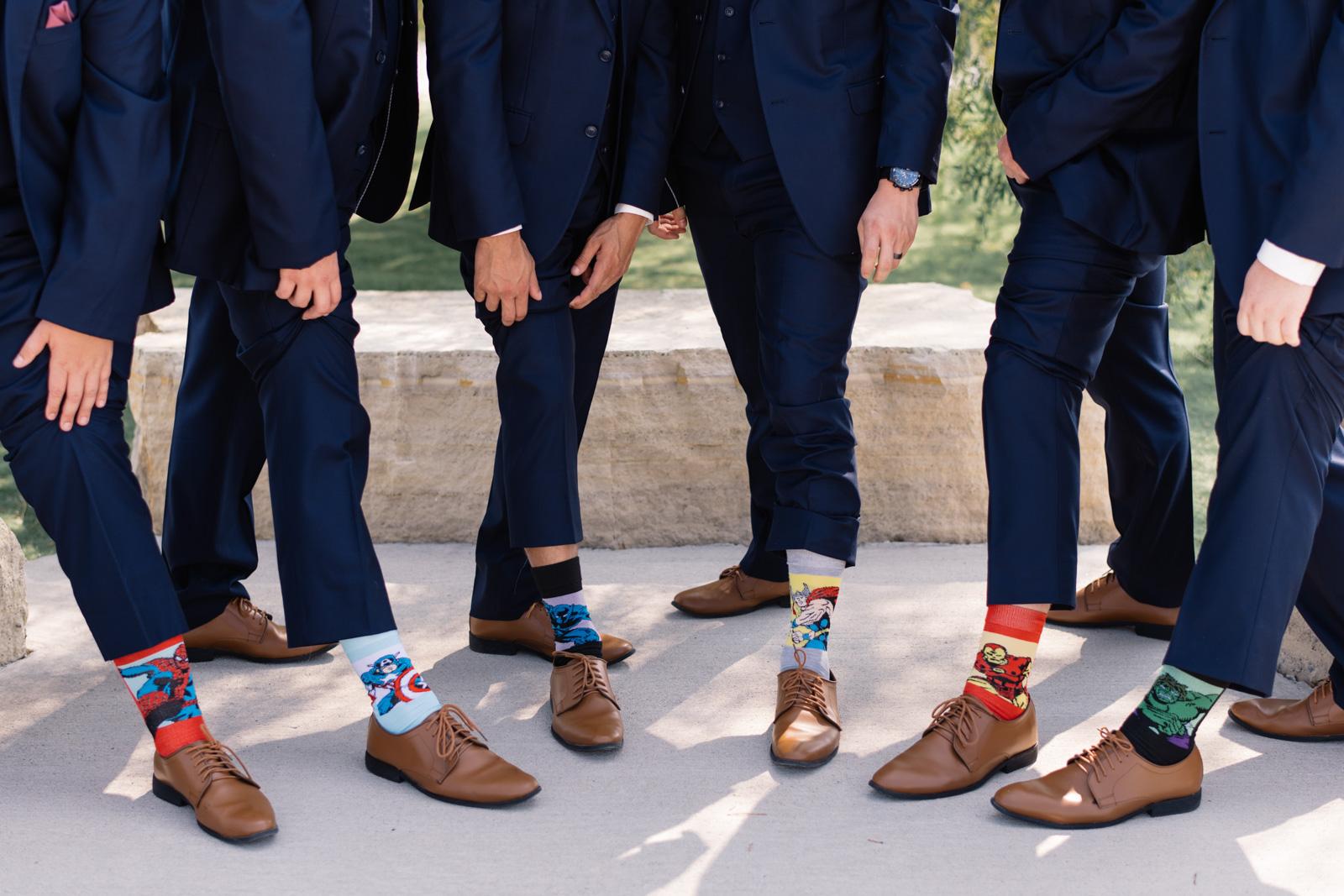 groomsmen wearing superhero socks epic event center wedding venue