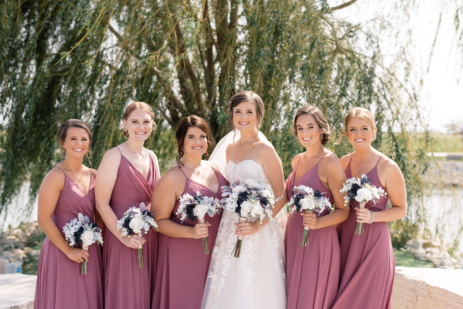 bridesmaids in purple dresses by willow tree epic event center wedding venue