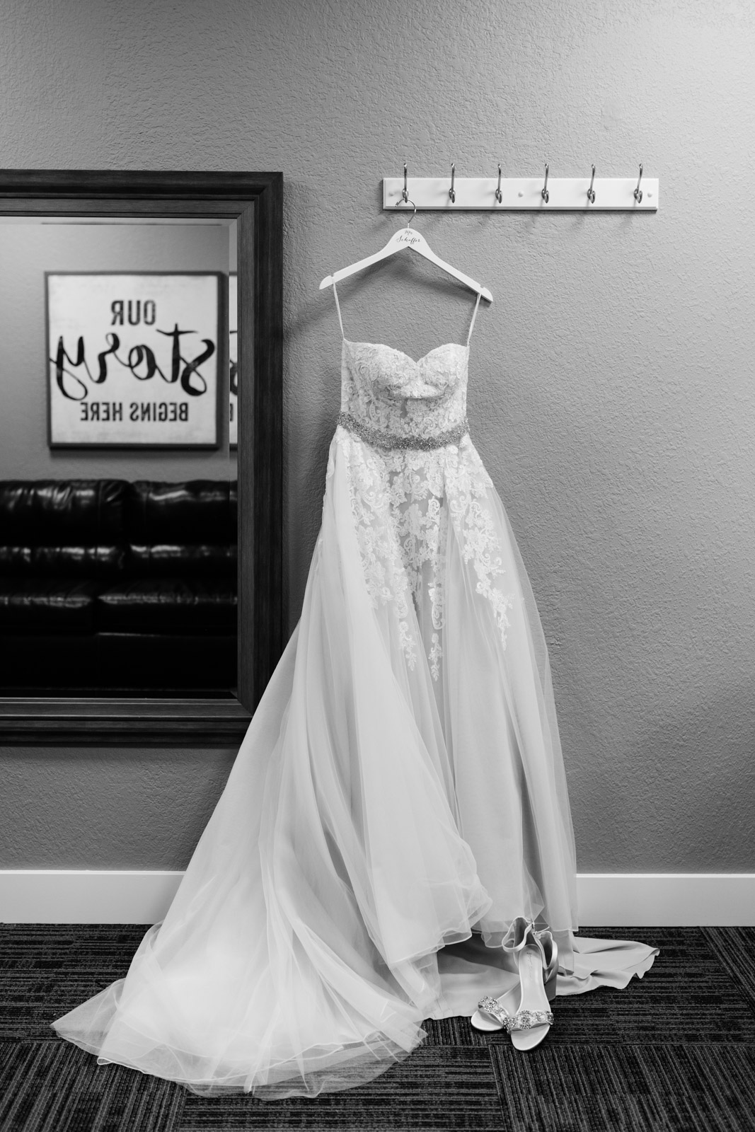 wedding dress hanging on wall epic event center wedding venue