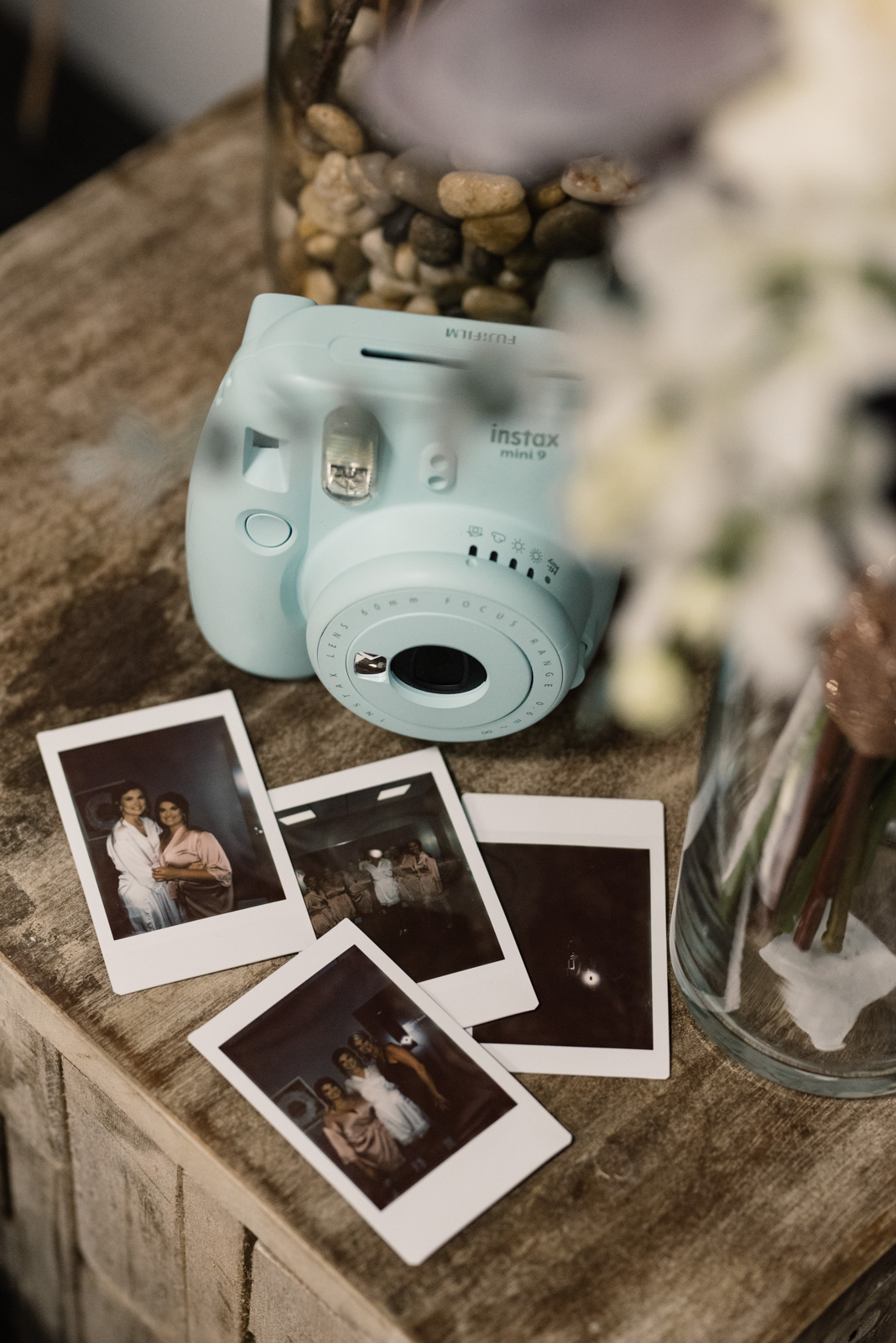 polaroid camera with wedding bouquet epic event center