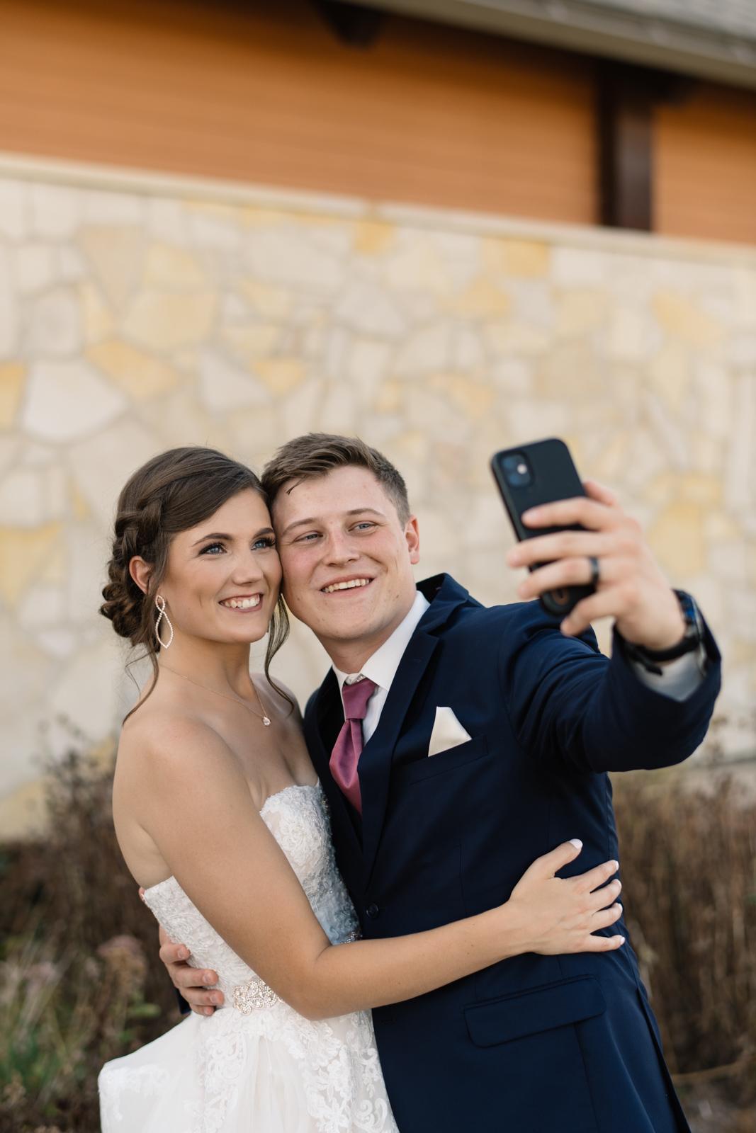 bride and groom taking selfie cedar rapids wedding