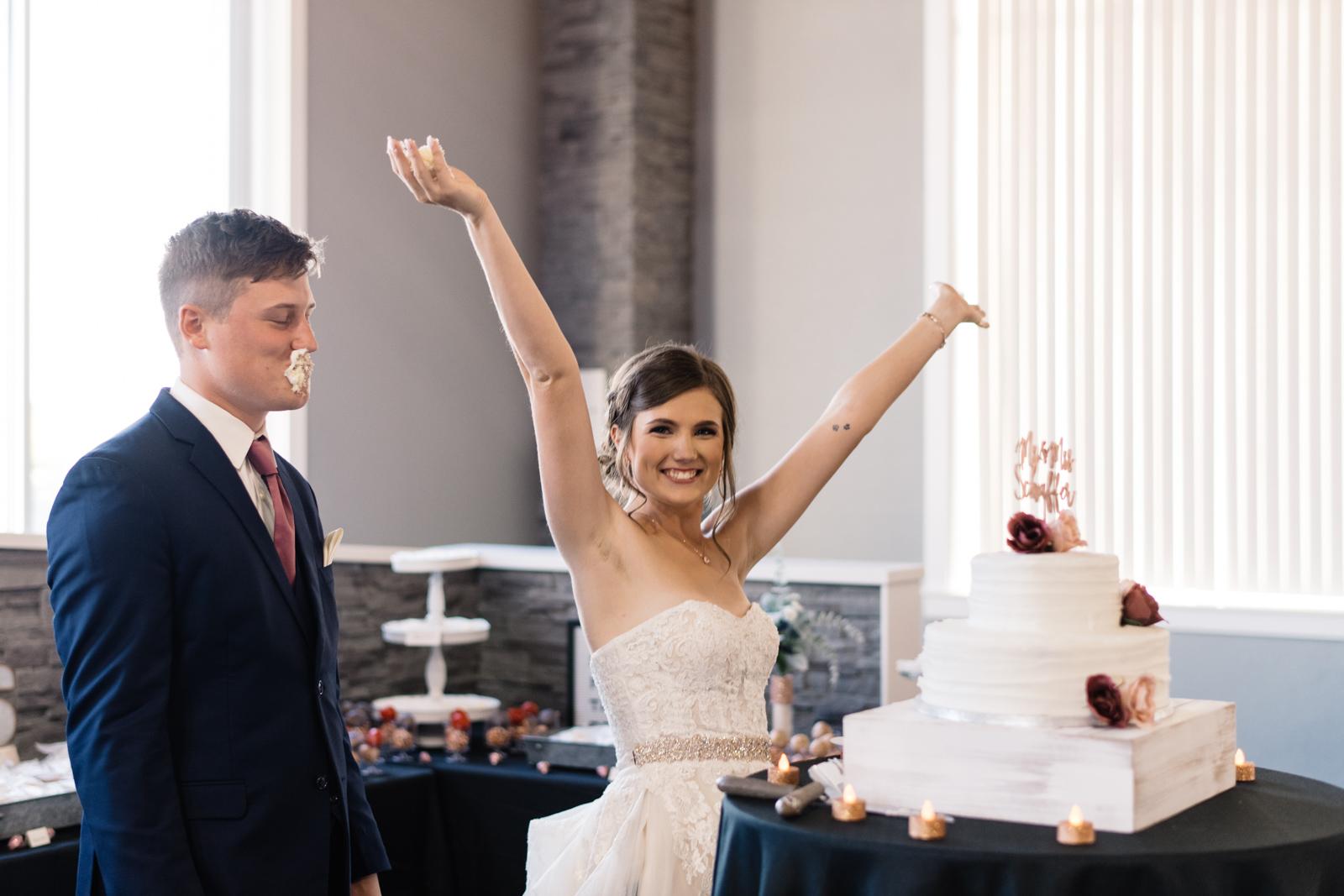 bride and groom cake smash cedar rapids wedding venue