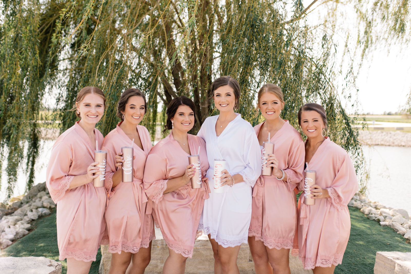 bridesmaids with matching pink robes epic event center wedding venue