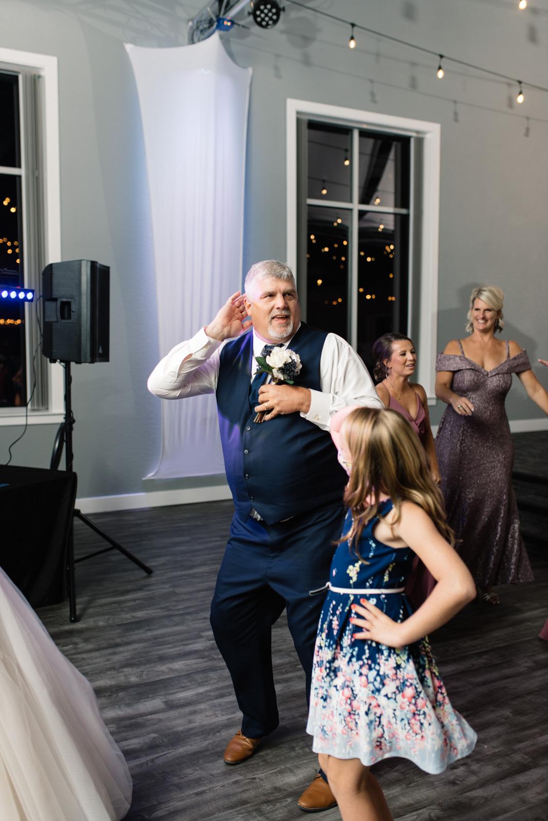 dad dancing at wedding reception epic event center cedar rapids wedding venue