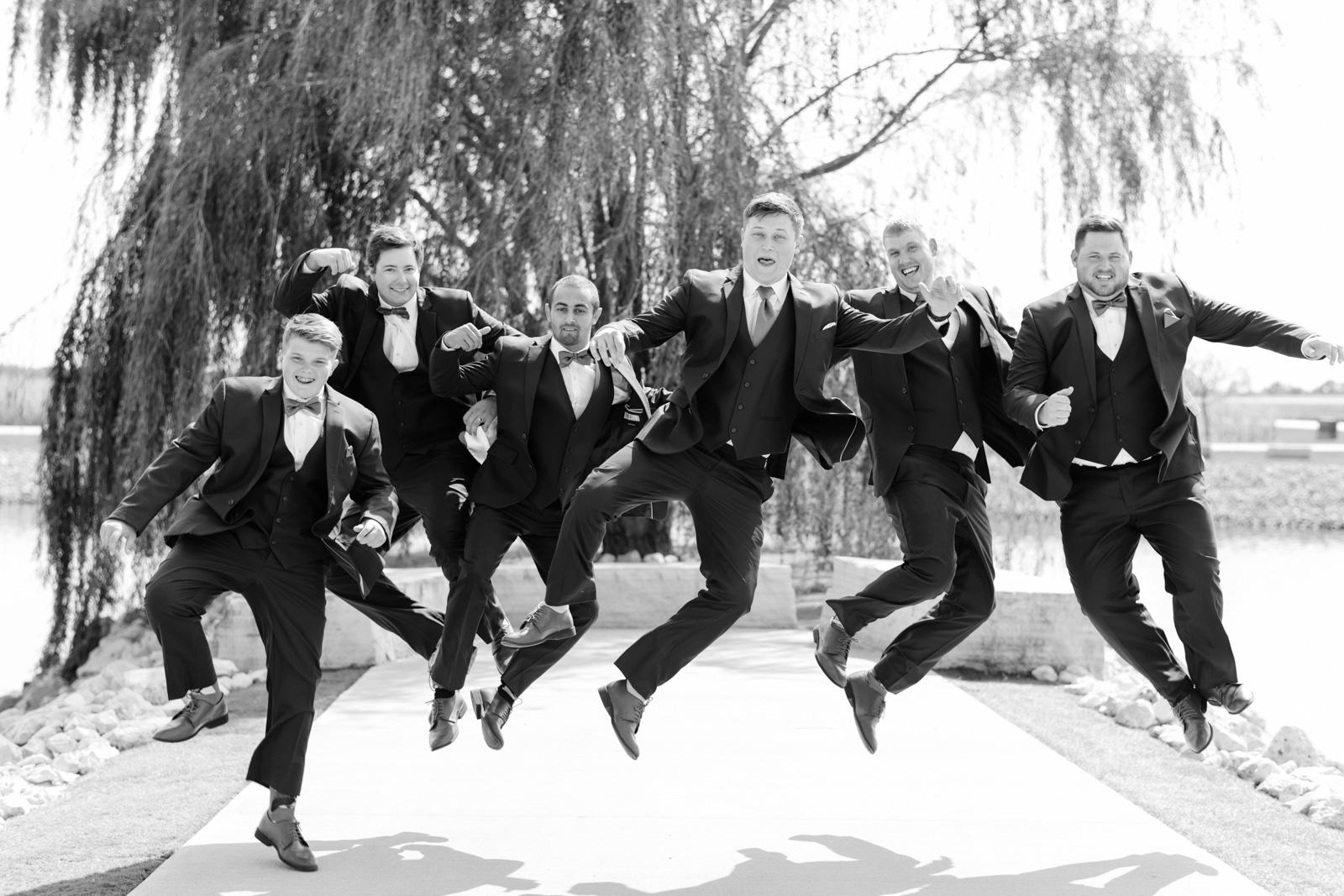 groomsmen in navy suits epic event center wedding venue