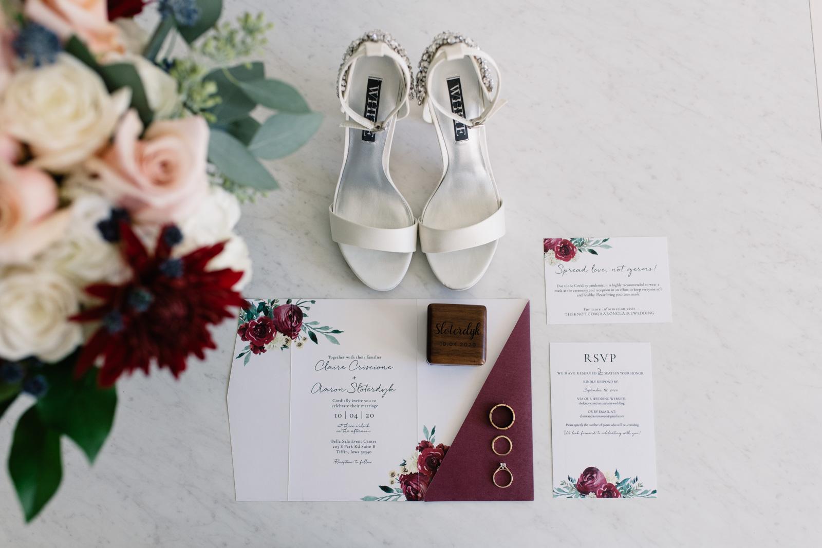 burgundy floral wedding invitation suite with wedding bouquet and shoes bella sala wedding venue tiffin iowa