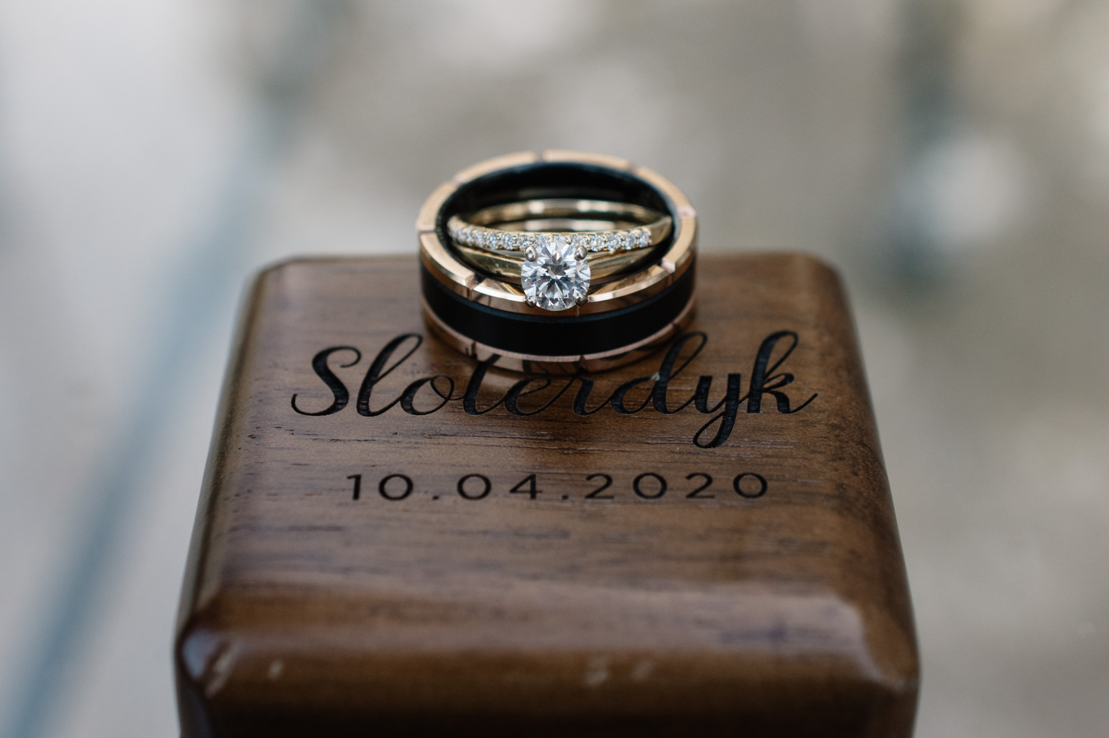 wedding rings on custom carved wood box bella sala weddings in tiffin iowa