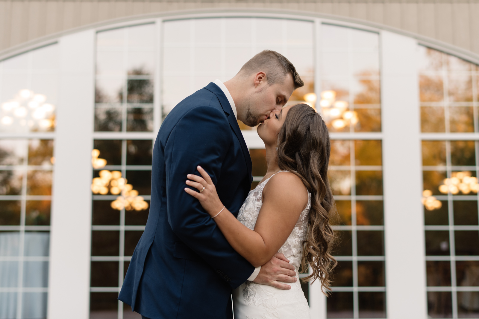 bride and groom outside at bella sala wedding venue in tiffin iowa